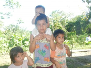 Children caring for children in Las Palmas village along the Amazon River