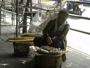 Street vendor selling rice in bamboo stick